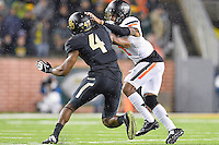 Oklahoma State cornerback Kevin Peterson (1) and Baylor wide receiver Jay Lee (4) during an NCAA football game, Saturday, November 22, 2014 in Waco, Tex. Baylor defeated Oklahoma State 49-28. (Mo Khursheed/TFV Media via AP Images)