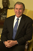 United States President-elect George W. Bush meets reporters with U.S. President Bill Clinton (not pictured), in the Oval Office of the White House in Washington, DC on December 19, 2000.<br /> Credit: Ron Sachs / Pool via CNP