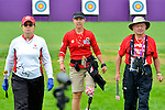 LONDON, ENGLAND 27/08/2012 - Linda Gagnon, Karen Van Nest and Vladimir Kopecky of the Canadian Paralympic Archery Team walk back from the targets after collecting the arrows during a training session at the London 2012 Paralympic Games at The Royal Artillery Barracks. (Photo: Phillip MacCallum/Canadian Paralympic Committee)