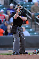 Umpire Ryan Blakney makes a call during a game between the Rochester Red Wings and Scranton Wilkes-Barre RailRiders on June 19, 2013 at Frontier Field in Rochester, New York.  Scranton defeated Rochester 10-7.  (Mike Janes/Four Seam Images)