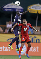WASHINGTON, DC - July 28, 2012:  Maicon Santos (29) of DC United loses a header to Mamadou Sakho (3) of PSG (Paris Saint-Germain) in an international friendly match at RFK Stadium in Washington DC on July 28. The game ended in a 1-1 tie.