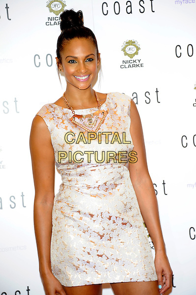 Alesha Dixon.Coast photocall, Oxford street, London, England..June 28th, 2012.half length white gold lace dress hair up bun necklace sleeveless .CAP/CJ.©Chris Joseph/Capital Pictures.