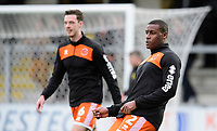 Blackpool's Ben Heneghan, left, and Blackpool's Donervon Daniels during the pre-match warm-up<br /> <br /> Photographer Chris Vaughan/CameraSport<br /> <br /> The EFL Sky Bet League One - Burton Albion v Blackpool - Saturday 16th March 2019 - Pirelli Stadium - Burton upon Trent<br /> <br /> World Copyright &copy; 2019 CameraSport. All rights reserved. 43 Linden Ave. Countesthorpe. Leicester. England. LE8 5PG - Tel: +44 (0) 116 277 4147 - admin@camerasport.com - www.camerasport.com