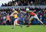 Conor Deasy of Sixmilebridge in action against Ryan Taylor of Clooney-Quin during their senior county final replay at Cusack park. Photograph by John Kelly.