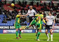 Bolton Wanderers' Josh Magennis heads at goal under pressure from West Bromwich Albion's Gareth Barry<br /> <br /> Photographer Andrew Kearns/CameraSport<br /> <br /> The EFL Sky Bet Championship - Bolton Wanderers v West Bromwich Albion - Monday 21st January 2019 - University of Bolton Stadium - Bolton<br /> <br /> World Copyright © 2019 CameraSport. All rights reserved. 43 Linden Ave. Countesthorpe. Leicester. England. LE8 5PG - Tel: +44 (0) 116 277 4147 - admin@camerasport.com - www.camerasport.com