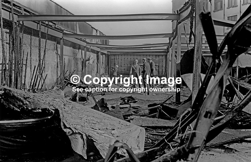 Belfast Co-operative management survey the damage caused to store in Donegall Street following its bombing by the Provisional IRA 5th October 1972. 197210050615<br />