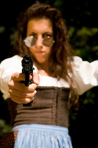 Young woman holding a 9mm gun German woman with a pistol