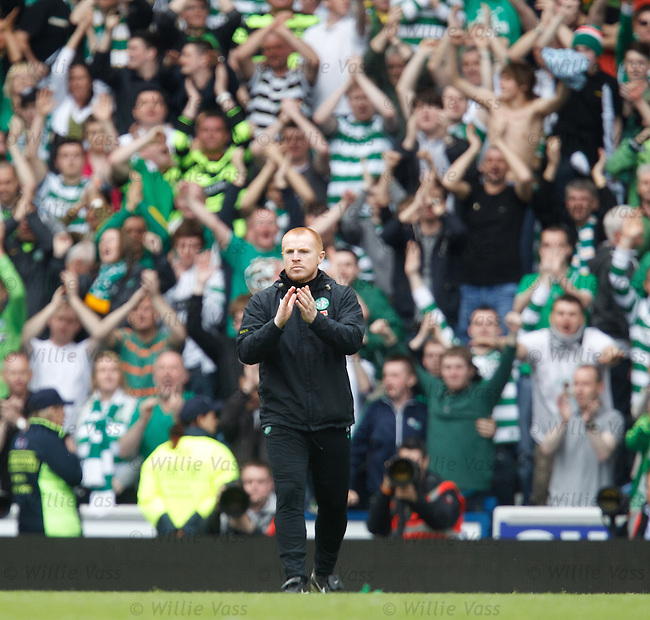 Neil Lennon cups his hands to his ears in front of the Rangers support at the end of the match