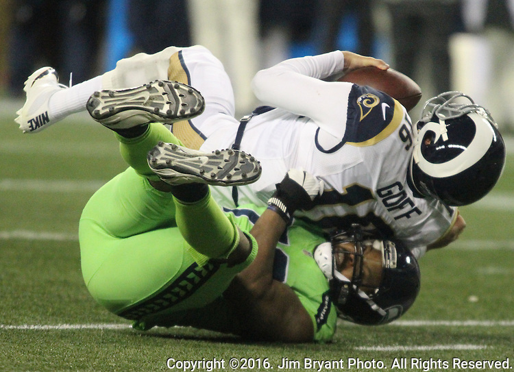 Los Angeles Rams quarterback Jared Goff (16) is sacked for a loss by Seattle Seahawks defensive end Michael Bennett (72) at CenturyLink Field in Seattle, Washington on December 15, 2016.  The Seahawks beat the Rams 24-3.  ©2016. Jim Bryant Photo. All Rights Reserved