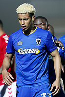 An angry Lyle Taylor of AFC Wimbledon is led away by team mates during the Sky Bet League 1 match between AFC Wimbledon and Charlton Athletic at the Cherry Red Records Stadium, Kingston, England on 10 April 2018. Photo by Carlton Myrie / PRiME Media Images.