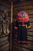A woman's gákti hangs on display at Nutti Sámi Siida. One can read their patterns like business cards. Each gákti immediately introduces its wearer upon sight by explaining which reindeer herding communities – siida - they hail from, which Sámi language dialects they speak, their marital status, and even down to which specific families they belong to.