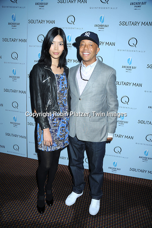 "Russell Simmons and date attending  The New York Premiere of ""Solitary Man"" starring Michael Douglas, Jenna Fischer, Imogen Poots at Cinema 2 on May 11, 2010 in New York City."