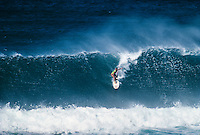 Freida Zamba (USA) surfing Sunset Beach Hawaii in 1989. Zamba is a four-time world surfing champion from the United States. She won three titles in a row from 1984 to 1986, then won again in 1988. She currently lives in Costa Rica. Photo: joliphotos.com