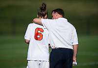 Virginia head coach Steve Swanson talks to Morgan Brian (6) after the game at Klockner Stadium in Charlottesville, VA.  Virginia defeated Duke, 1-0.