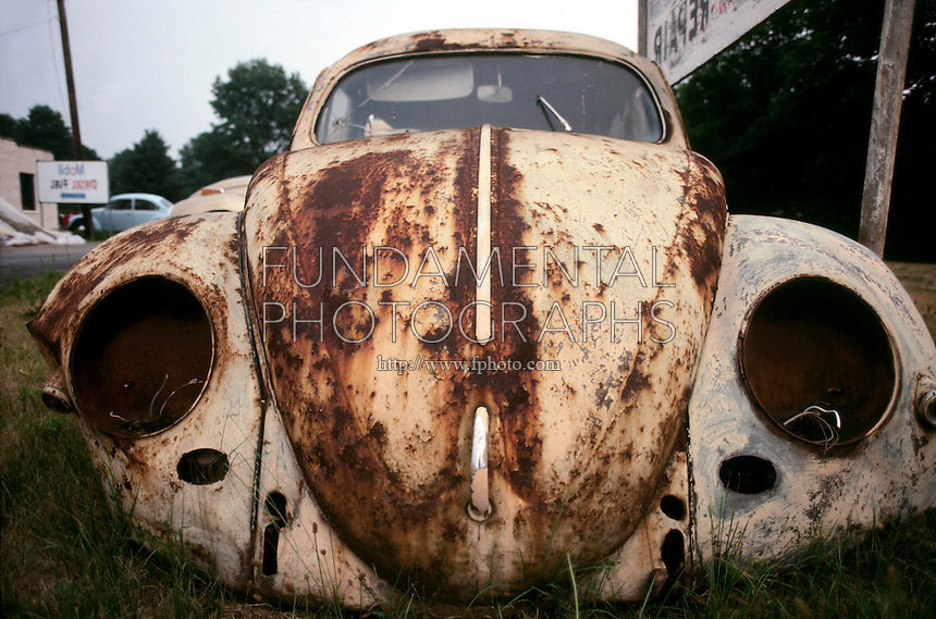 RUST ON CAR<br /> Oxide of iron formed by corrosion, an electrochemical reaction.  In moist conditions iron is rapidly oxidized by oxygen to form rust, a mixture of iron oxides.