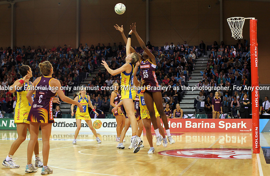 10.04.11 Pulse's Katrina Grant and Firebird's Romelda Aiken in action during the Round 9 ANZ Championships netball match between the Pulse and Firebirds played at Te Rauparaha Arena in Porirua in New Zealand. Mandatory Credit ©MBPHOTO/Michael Bradley.