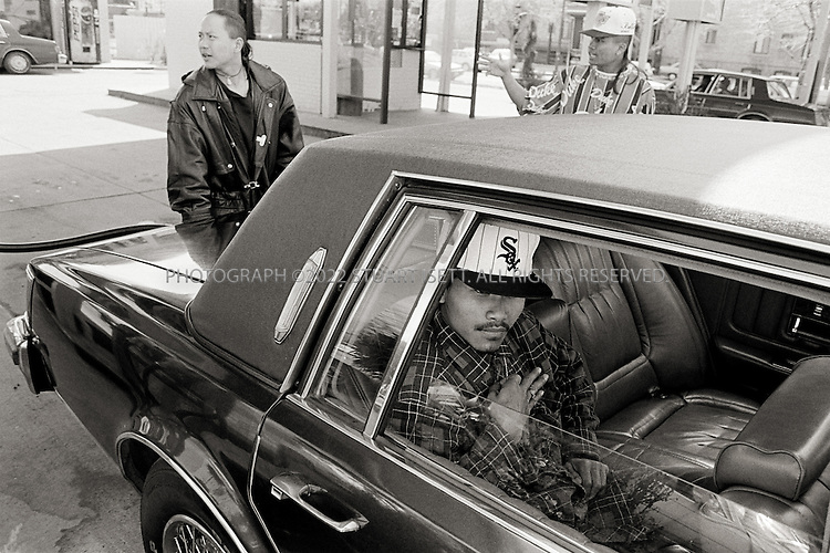 1995--Chicago, USA.  Ricky flashes a gang sign at a gas station....All photographs ©2003 Stuart Isett.All rights reserved.This image may not be reproduced without expressed written permission from Stuart Isett.