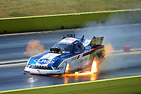 Sept. 23, 2012; Ennis, TX, USA: NHRA funny car driver Tim Wilkerson lights it up on fire as he explodes an engine during the Fall Nationals at the Texas Motorplex. Mandatory Credit: Mark J. Rebilas-