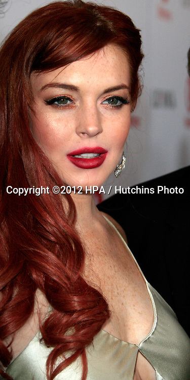 LOS ANGELES - NOV 20:  Lindsay Lohan arrives to the private dinner for the premiere of Lifetime's 'Liz & Dick'  at Beverly Hills Hotel on November 20, 2012 in Beverly Hills, CA