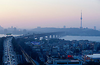 Wuhan, Yangzi River Bridge, sunset seen from Yellow Crane Tower. This city of more than 10 Million people is not far below Three Gorges Dam, the break of which would cause an unprecedented catastrophe.