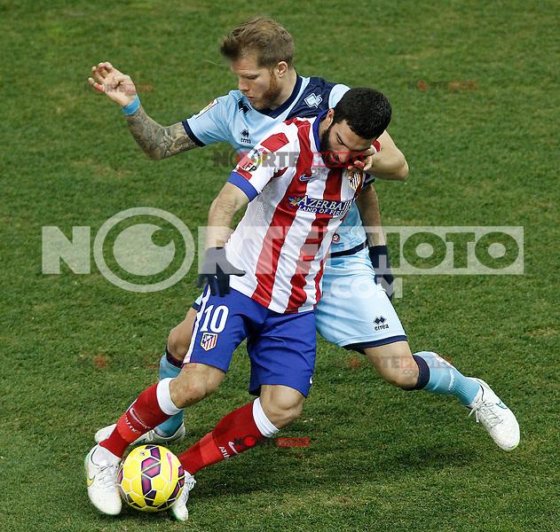 Atletico de Madrid's Arda Turan (l) and Rayo Vallecano's Jorge Garcia Morcillo during La Liga match.January 24,2015. (ALTERPHOTOS/Acero) /NortePhoto<br /> NortePhoto.com
