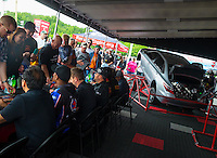 Jun 6, 2015; Englishtown, NJ, USA; Fans file by getting autographs and pictures of the favorite NHRA Toyota drivers in front of the Toyota, Sleeper Camry during qualifying for the Summernationals at Old Bridge Township Raceway Park. Mandatory Credit: Mark J. Rebilas-