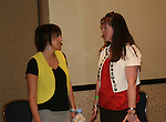 """OLTL's Farah Fath """"Gigi"""" chats with a fan at the One Life To Live Fan Club Luncheon on August 16, 2008 at the New York Marriott Marquis, New York, New York.  (Photo by Sue Coflin/Max Photos)"""