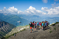 Germany, Bavaria, Upper Allgaeu, Oberstdorf: with Nebelhorn cable car in three sections up to summit Nebelhorn 2224 m, ornithologist with group hoping for encounter with the Golden Eagle | Deutschland, Bayern, Oberallgaeu, Oberstdorf: mit der Nebelhornbahn geht es in drei Etappen hinauf zum Nebelhorn 2224 m, Gruppe mit Ornithologen als Bergfuehrer hoffen auf Begegnungen mit dem Steinadler