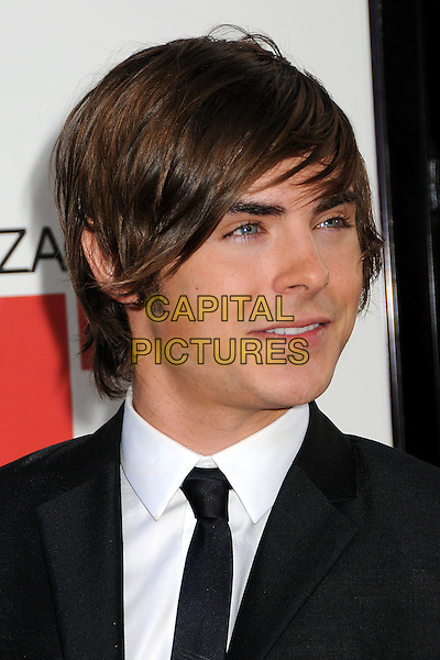 "ZAC EFRON.""17 Again"" Los Angeles Premiere held at Grauman's Chinese Theatre, Hollywood, CA, USA, 14th April 2009. .portrait headshot black tie messy hair white shirt  profile .CAP/ADM/BP.©Byron Purvis/Admedia/Capital PIctures"