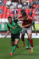Michal Zyro of Charlton Athletic out jumps Scunthorpe's Jordan Clarke during Charlton Athletic vs Scunthorpe United, Sky Bet EFL League 1 Football at The Valley on 14th April 2018