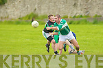 Paudie O'Connor Pass the ball as David Rolls of Churchill .