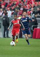 21 April 2012: Toronto FC forward Joao Plata #7 and Chicago Fire defender Dan Gargan #3 in action during the first half in a game between the Chicago Fire and Toronto FC at BMO Field in Toronto...