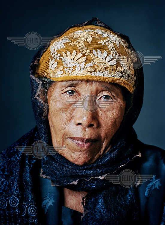 """Niyem (born 1933) was one of tens of thousands of 'comfort women' forced into prostitution by the Japanese military during World War II..As a 10-year-old child, Niyem was kidnapped while playing and taken in a truck full of women to a military tent camp in West Java. Once there, the prettiest women were locked up as live-ins by officers in their residences. Niyem had to share a small tent with two other girls, where soldiers raped them in the presence of others. She didn't get much to eat and had to drink water from a ditch. """"I was still so young, within two months my body was completely destroyed. It's sufficient that I have had to go through it, my grandchildren should be spared this kind of thing. I was nothing but a toy, as a human being I meant nothing, that's how it felt during the Japanese era."""" After two months, Niyem managed to escape with a small group when the guards weren't paying attention. After she returned home, her parents didn't recognize her because she had become very thin and hadn't been able to wash her hair for months. """"I didn't dare tell anyone that I had been raped, I didn't want to hurt my parents. I was afraid that no one would want me, that I would be left out. But people still abused me by calling me a 'Japanese hand-me-down'. Because I had been gone so long, they suspected what had happened. It hurt me tremendously."""" She managed to get married only at an older age, to an old widower. But she is very grateful that as an old spinster, she found a husband and had five children: """"Without children, you have no history.""""."""