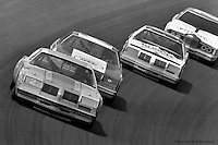 TALLADEGA, AL - MAY 4: Dale Earnhardt leads a group of cars through Turn 4 during the Winston 500 on May 4, 1980, at the Talladega Superspeedway near Talladega, Alabama.