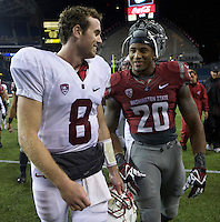 SEATTLE, WA - September 28, 2013: Stanford quarterback Kevin Hogan, left, and Washington State safety Deone Bucannon talk while walking off the field  after a game at CenturyLink Field. Stanford won 55-17.