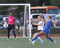 Boston Breakers forward Kyah Simon (17) attempts to block a clearing pass. In a National Women's Soccer League (NWSL) match, Boston Breakers (blue) defeated Portland Thorns FC (white/black), 2-1, at Dilboy Stadium on August 7, 2013.