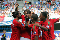 FAO SPORTS PICTURE DESK<br /> Pictured: Michu (2nd L) of Swansea mobbed by team mates celebrating his opening goal. Saturday 18 August 2012<br /> Re: Barclay's Premier League, Queens Park Rangers v Swansea City FC at Loftus Road Stadium, London, UK.