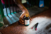 A man picks a bottle of medicine at the pharmacy in Duncan Hospital in Raxaul of East Champaran district of Bihar, India. Photograph: Sanjit Das/Panos for Legatum Foundation