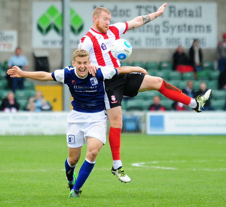 Lincoln City's Alan Power vies for possession with Barrow's Ryan Yates<br /> <br /> Photographer Andrew Vaughan/CameraSport<br /> <br /> Vanarama National League - Lincoln City v Barrow - Saturday 17 September 2016 - Sincil Bank - Lincoln<br /> <br /> World Copyright &copy; 2016 CameraSport. All rights reserved. 43 Linden Ave. Countesthorpe. Leicester. England. LE8 5PG - Tel: +44 (0) 116 277 4147 - admin@camerasport.com - www.camerasport.com
