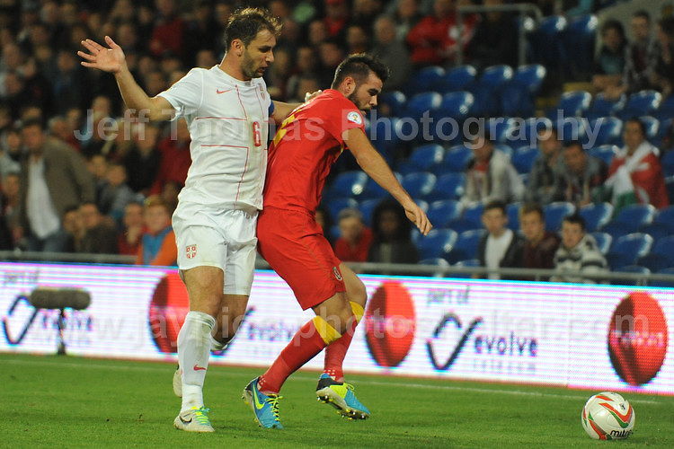Joe Ledley of Wales and Celtic battles with Ivanovic of Serbia and Chelsea during the Wales v Serbia FIFA World Cup 2014 Qualifier match at Cardiff City Stadium, Cardiff, Wales -Tuesday 10th Sept 2014. All images are the copyright of Jeff Thomas Photography-07837 386244-www.jaypics.photoshelter.com