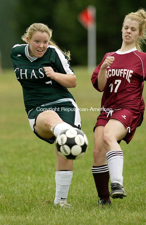 WATERBURY, CT 9/22/07- 092207BZ11- Chase Collegiate School's Erin Boyd (7) battles MacDuffie's Katie Garrett  (17) Saturday afternoon.<br /> Jamison C. Bazinet Republican-American