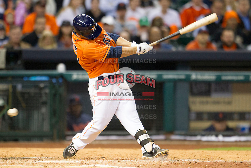 Houston Astros second baseman Jose Altuve (27) swings the bat during the MLB baseball game against the Detroit Tigers on May 3, 2013 at Minute Maid Park in Houston, Texas. Detroit defeated Houston 4-3. (Andrew Woolley/Four Seam Images).