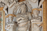 Figures in carved stucco from the frame of the fresco Fire or the Twins of Catania by Rosso Fiorentino, 1535-37, in the Galerie Francois I, begun 1528, the first great gallery in France and the origination of the Renaissance style in France, Chateau de Fontainebleau, France. The Palace of Fontainebleau is one of the largest French royal palaces and was begun in the early 16th century for Francois I. It was listed as a UNESCO World Heritage Site in 1981. Picture by Manuel Cohen