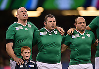 Paul O'Connell and Mike Ross of Ireland sing their national anthem. Rugby World Cup Pool D match between France and Ireland on October 11, 2015 at the Millennium Stadium in Cardiff, Wales. Photo by: Patrick Khachfe / Onside Images