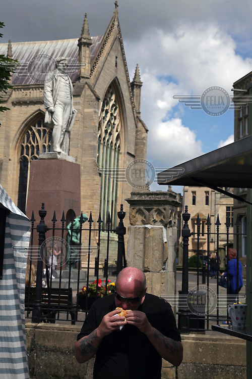 A man eats a snack near the near St Botolph's Church in the town centre. <br /> The town of Boston had the country's highest proportion of 'leave' votes cast in the EU referendum with almost 76 percent of ballots cast for Brexit. Lincolnshire has, in recent years, seen an influx of EU workers drawn to the area's agricultural industry. The 2011 census found about 13 percent of Boston's residents were born in Eastern Europe and migrated to the UK since 2004.