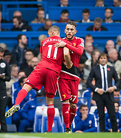 Richarlison congratulates Roberto Pereyra of Watford on his goal during the Premier League match between Chelsea and Watford at Stamford Bridge, London, England on 21 October 2017. Photo by Andy Rowland.