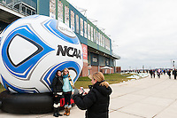 Fans get their picture taken in front of a giant inflatable soccer ball prior to the championship match of the division 1 2013 NCAA  Men's Soccer College Cup at PPL Park in Chester, PA, on December 15, 2013.