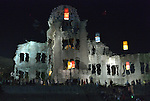 The reflection in the river of the atomic bomb dome in Hiroshima, Japan. Floating in the river are candle lanterns, thousands of which were launched on August 6, 2015, the 70th anniversary of the atomic bombing of the city. Each floating lantern carries handmade messages and drawings, conveying each person's prayers for peace and comfort for the victims of the violence. The dome is now a memorial to those killed and injured in the bombing.