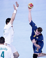 Australia's Tommy Fletcher (r) and Hungary's Tamas Mocsai during 23rd Men's Handball World Championship preliminary round match.January 14,2013. (ALTERPHOTOS/Acero) /NortePhoto