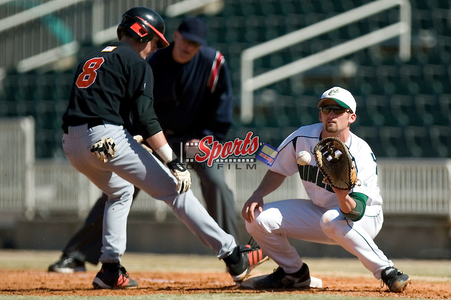 Charlotte first baseman Alex Burt (11) waits for the throw as Campbell's Jacob Allen (8) gets back to first base at Fieldcrest Cannon Stadium in Kannapolis, NC, Saturday, February 24, 2007.  The Charlotte 49'ers defeated the Campbell Camels 13-2.